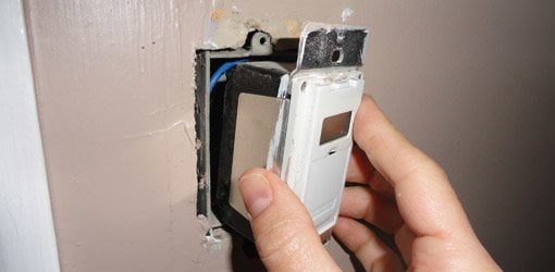 Installing a programmable timer switch in a wall electrical box