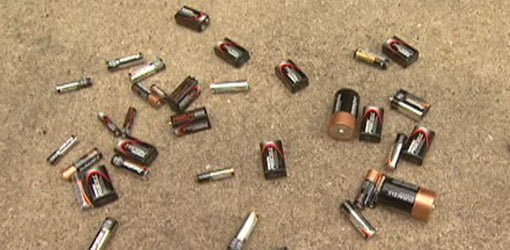 Used batteries on ground
