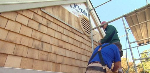 Installing cypress wood siding shakes on gable of house