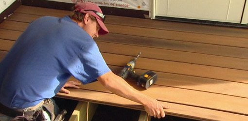 Composite decking being installed on a porch floor