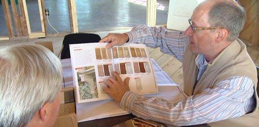 Designer Joe Boehm, of Better Homes & Gardens magazine, going over the cabinet design.
