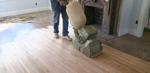 Drum sander sanding heart pine floor