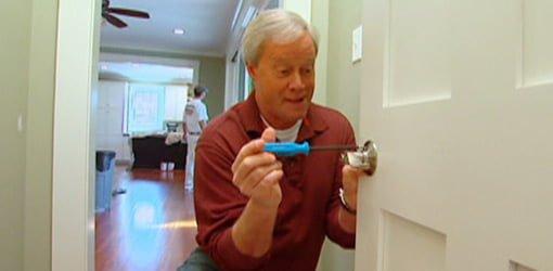 Danny Lipford installing a lockset on a door