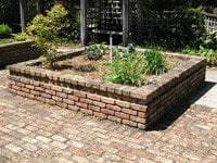 Brick raised bed with easy access