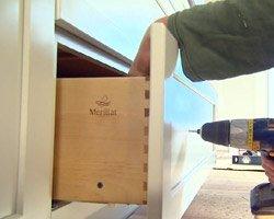 Installing cabinet hardware.