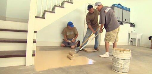 Rolling epoxy coating on concrete slab of garage floor