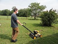 Dust mask cutting grass