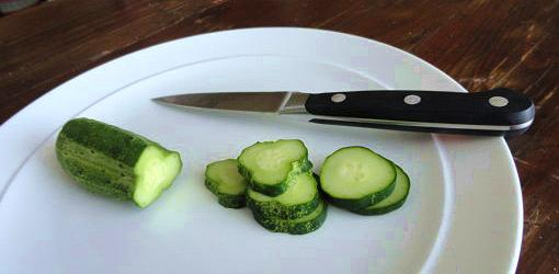Fresh cucumbers sliced on a plate