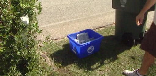 Recycling bin at curb for pickup