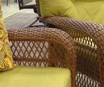 Brown synthetic wicker outdoor furniture with green cushions