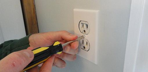 Unscrewing an outlet cover plate