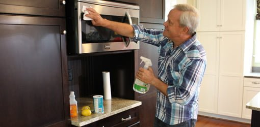 Danny Lipford cleaning microwave door with green eco-friendly cleaner