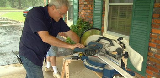 Danny Lipford cutting crown molding on a power miter saw