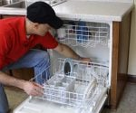 Joe Truini loading a dishwasher