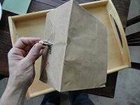 Paper bag with hole cut in it for herbs