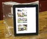 iPad in sealed plastic bag.