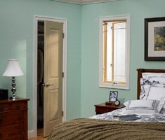 Bedroom with less expensive JELD-WEN door and window