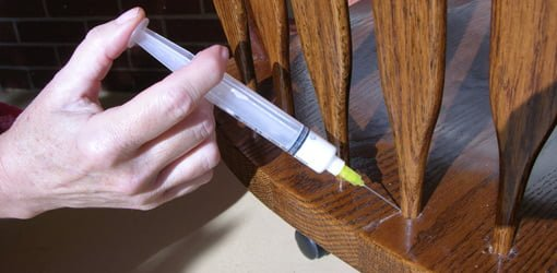Injecting Briwax ChaiRX into the joint on a chair