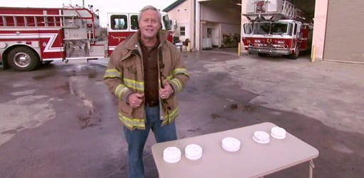 Danny Lipford at fire station with smoke detectors.
