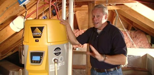 Danny Lipford in attic with energy efficient Vertex hot water heater.