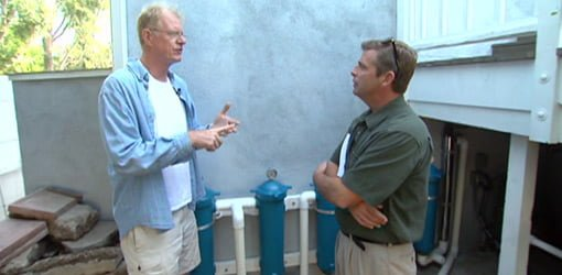 Ed Begley, Jr. explains his graywater recycling system to Allen Lyle.