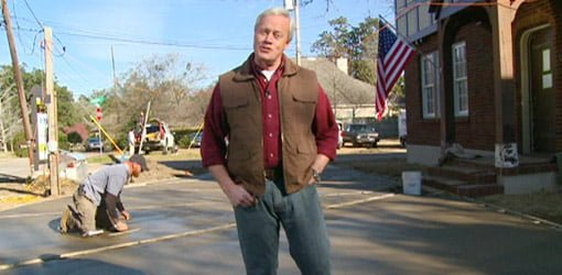 Danny Lipford standing in front of poured concrete driveway.