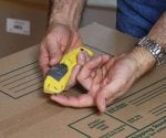 Using a utility knife to open boxes without damaging the contents.