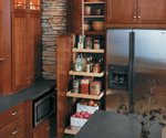 Kitchen with wood cabinets and pullout pantry