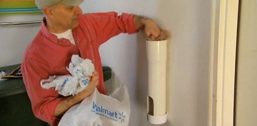 Putting plastic bags in PVC pipe storage tube