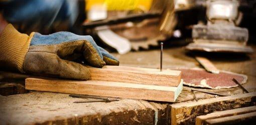 Hammering nail into board