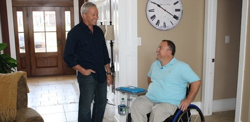 Danny Lipford with homeowner in wheelchair.