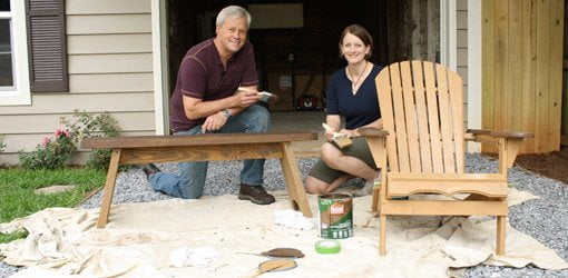 Danny Lipford and Julie Day-Jones refinishing outdoor wood furniture.