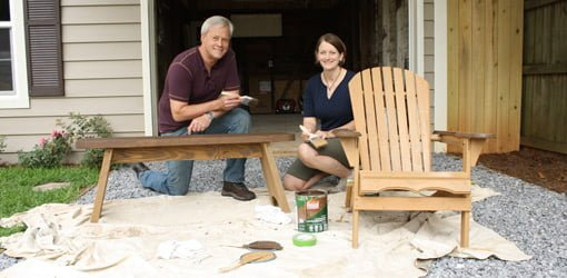 Danny Lipford and Julie Day Jones staining outdoor wood furniture.