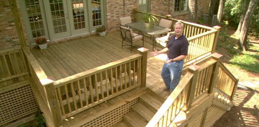 Danny Lipford with completed wood deck on home