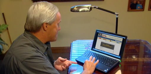 Home improvement expert Danny Lipford anwering questions on computer.