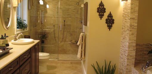 Completed bathroom renovation with glass door shower.