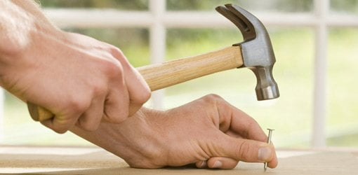 Hammering a nail into a board