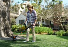 Woman using the Worx GT cordless string trimmer and edger