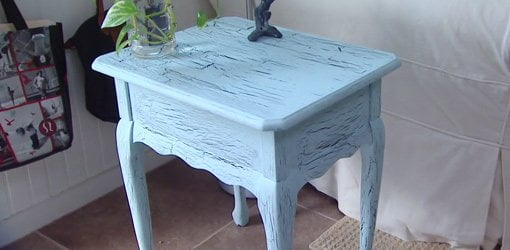 Side table with crackle paint finish.