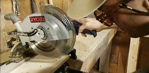 Joe Truini making a cut on a motorized miter saw.