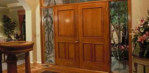 Natural wood entry doors on home.