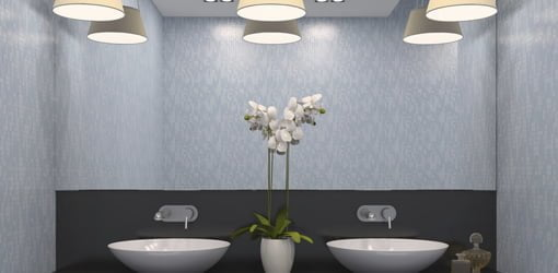 Dual bathroom sinks with multibulb overhead lighting.