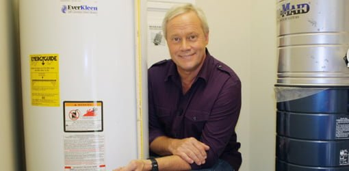 Danny Lipford next to hot water heater.