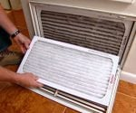 Changing the air filter on the return of a home HVAC system.