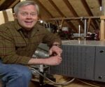 Danny Lipford in attic with HVAC furnace system.