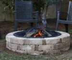 Completed backyard fire pit built from a kit.