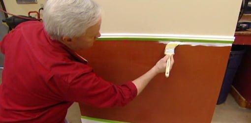 Danny Lipford painting wall below chair rail.