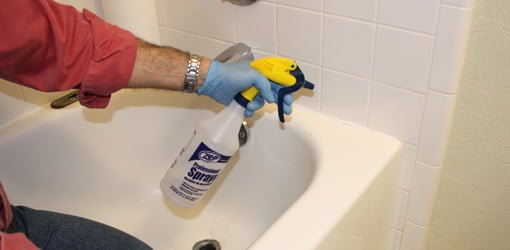 Misting a bead of silicone caulking with denatured alcohol to make it easy to spread.