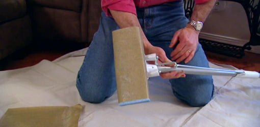DIY pole sander made from a standard sponge mop.
