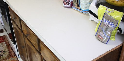 Kitchen countertop before applying faux granite paint finish.